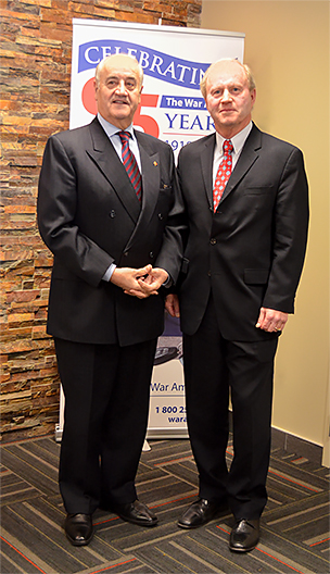 The Honourable Julian Fantino, Minister of Veterans Affairs (left), and Brian Forbes, Chairman of The War Amps Executive Committee.